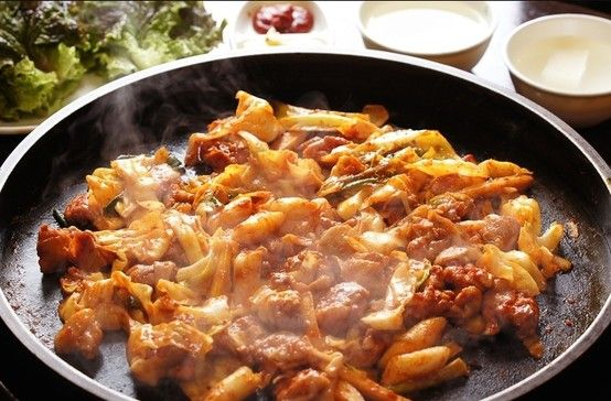 Chuncheon Dakgalbi , Gangwon Province Which gochujang-covered chunk is chicken? And which is cabbage? Doesn't matter, it's all dakgalbi now.