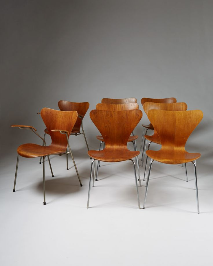 Arne Jacobsen. Teak plywood. Two armchairs and six side chairs. Sold as a set.