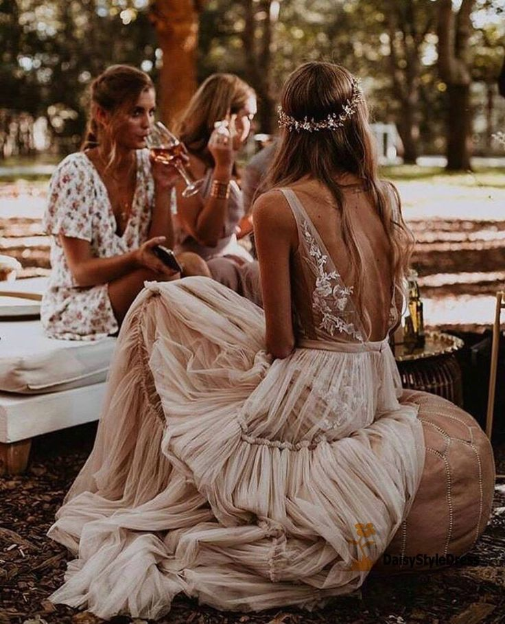 Sexy Open Back Deep V-neckline Bohemian Wedding Dress.The professional tailors from wedding dress manufacturer custom this informal bohemian wedding dress with any sizes and many other colors.Contact us to custom your own wedding dress online.