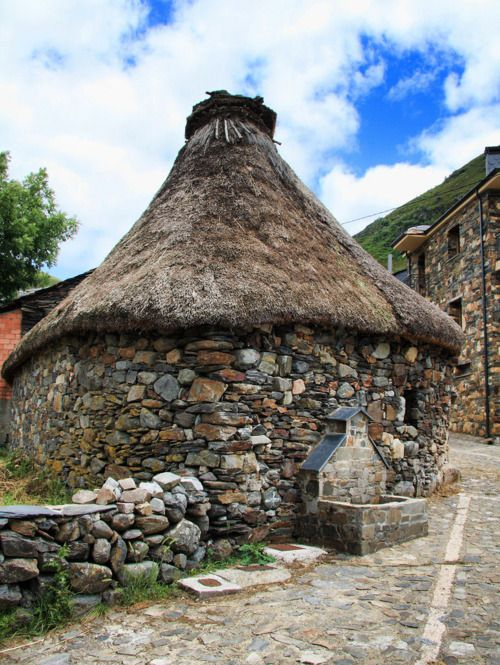 Palloza,Balouta, Los Ancares Thatched stone building. Small water trough at the side.