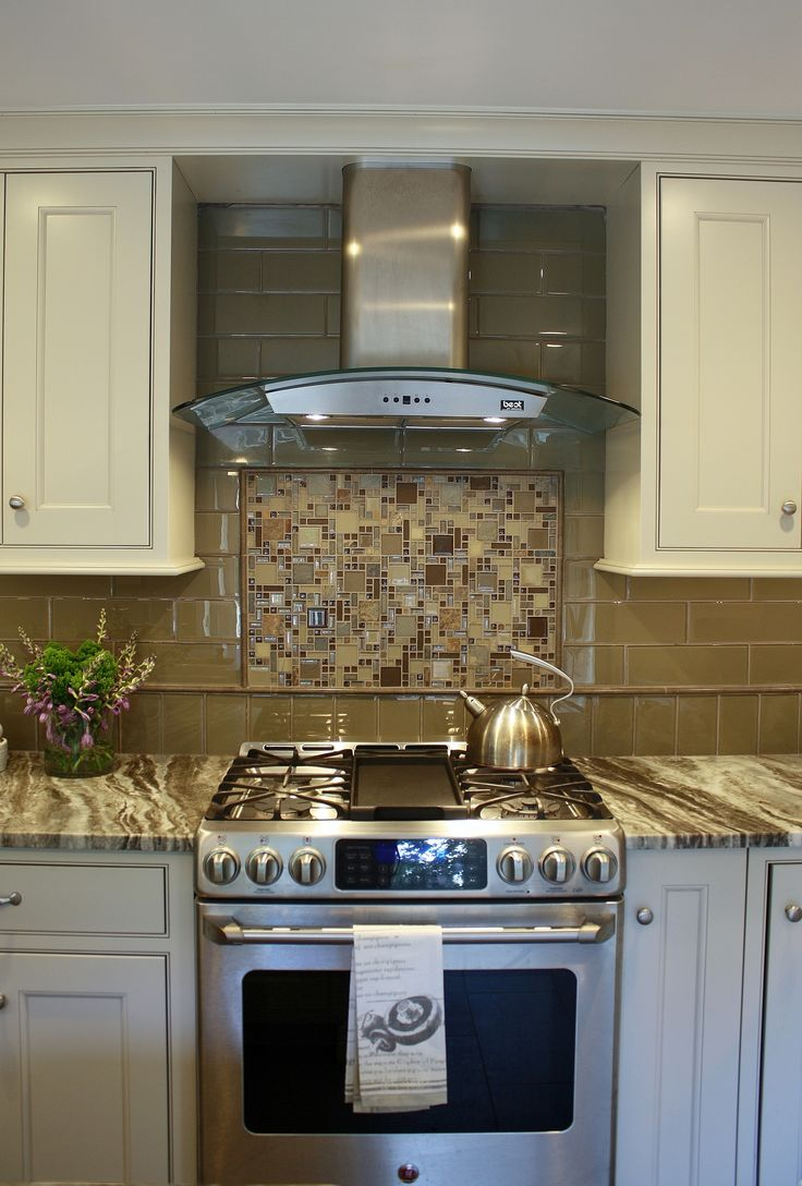 Brown Fantasy Leathered Quartzite Countertops With White Cabinets And A Glass Tile Backsplash