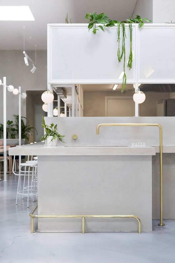 Concrete, hand-painted tiles and brass all feature in this Melbourne cafe, designed by local studio Biasol in tribute to the city's old Greek delicatessens