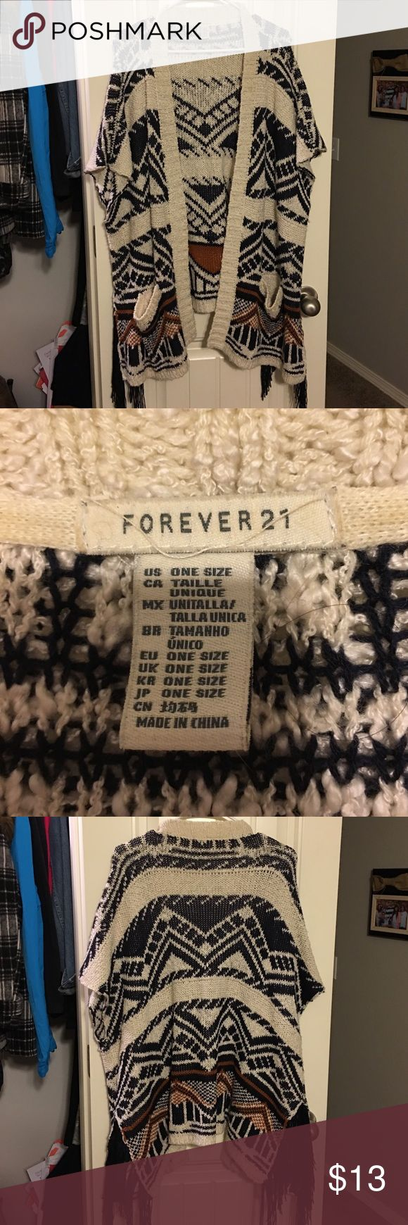 Women's Aztec print cardigan Women's Aztec print cardigan with fringe sides. Size One Size. Brand Forever 21. Forever 21 Sweaters Cardigans