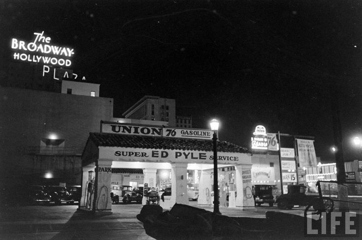 There's always something so deliciously film noir about well-lit night photos of Hollywood, isn't there? This shot from Life magazine show us the Ed Pyle Union 76 gas station at Selma Ave and Vine St., Hollywood, circa 1930s, and I love how the neon signs for The Broadway department store and the Hollywood Brown Derby restaurant punctuate the black sky.
