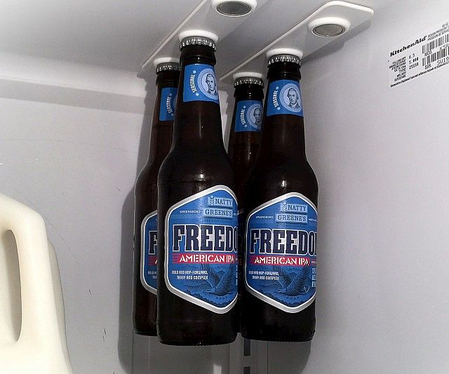 Free up some space and make your refrigerator cooler withthe magnetic bottle holders! The holders are placed on the fridge's ceiling and come equipped with small magnets designed to suspend your beer bottle by its metallic top.