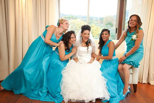 We love this upbeat blue as a colour theme - and the bride stands out beautifully thanks to the colour contrast. Dresses from Bride&co. Click to view more.