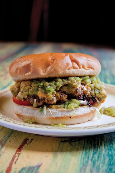 Hot Stuff: A road trip across New Mexico unearths the state's finest chile peppers. Green chile is added to hamburgers among other foods. Delightful! Try it, New Mexicans add chile to foods as a condiment, the hotter the better.