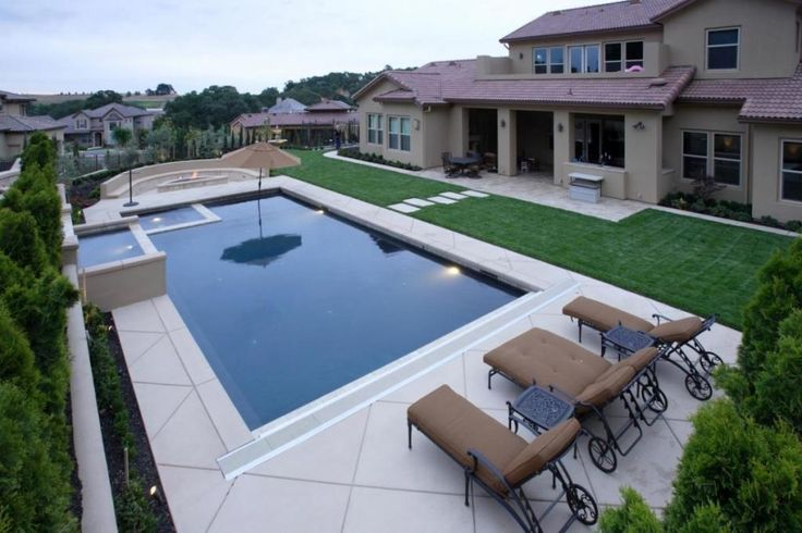 Amusing pool design in backyard with brown sleepr sofa o ceramic tile floor also green grass in the nearby