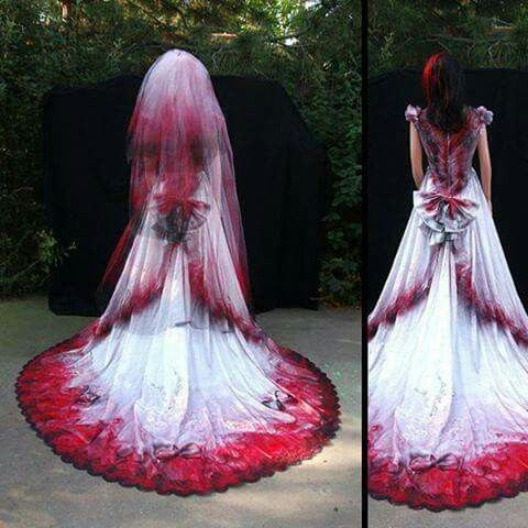 Love the red and black coloration of this dress and veil