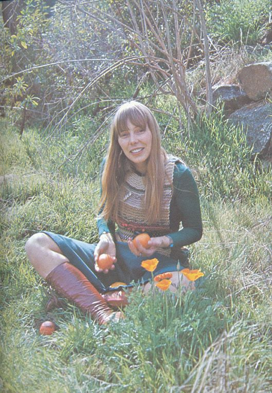 """The Painter derailed by circumstance"" Born Roberta Joan Anderson in Fort Macleod in 1943. Her wide ranging contralto vocals, open guitar and piano work have moved from folk to jazz, R'n'B and lush pop. Mitchell has accrued single sales of excess of a million copies in the US. Her singles. Big Yellow Taxi"" and ""Woodstock"" defined a generation."