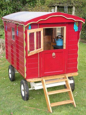 Child's garden playhouse wagon. I wish I'd had one of these.