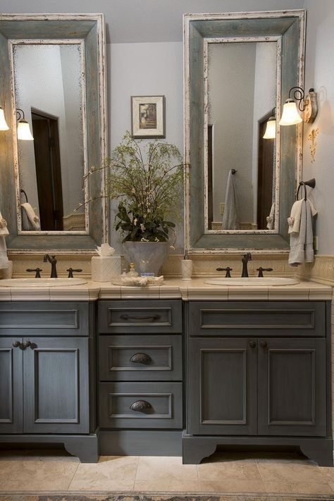 MFrench Country bathroom, gray washed cabinets, mirrors with painted frames, chippy paint...
