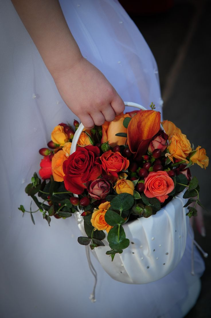 A flower girl basket of fall blooms at Doubletree. The Pros Photography.