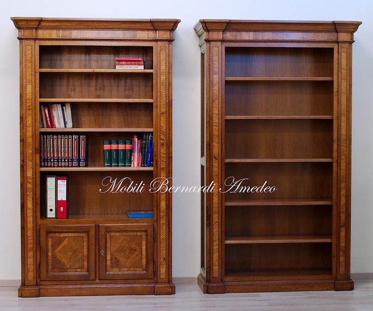 Classic bookcases in solid walnut with olive wood inlays ad adjustable shelves, handmade in Italy.