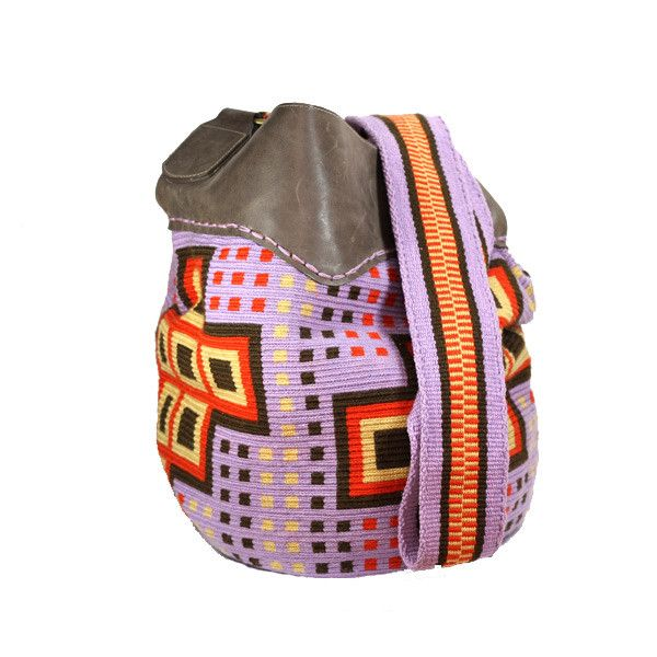 """This #ColombianStyle #handmade #mochila is called """"Leather Mochila #Wayúu"""". Two Wayúu women take approximately 25 days to make it. The design is at the bag of the mochila with purple, brown, orange and bone thread colors. The leather is brown; it covers the top of the bag. The strap is thick with same color of the bag.  #Colombian #Style offers you #vibrant colors and beautiful patterns that represent the universe and nature. This #bags is a #unique piece of #art."""