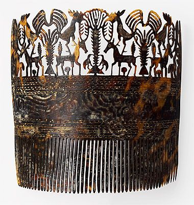 Indonesia ~ east Sumba | Woman's comb [hai kara jangga] | Turtle shell | late 19th/early 20th century | The combs of Sumba are among the most intricately carved in Indonesia. Worn on the front of the head, tortoise-shell combs are presented to adolescent girls by their fathers and may also be worn by adult women of the noble class. The animal motifs they display are associated with fertility, power and protection.