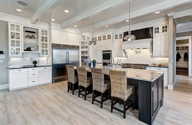 Clark and Co. Homes Spring 2014 Parade Home. Benjamin Moore Revere Pewter wall color with White Dove tongue and groove paneled ceiling and shaker style cabinets. Benjamin Moore Jet Black island and hood in high gloss.