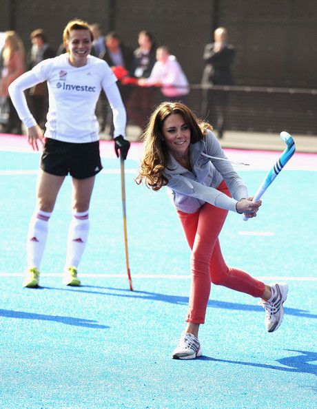 Women's Team GB hockey captain Kate Walsh watches Catherine, Duchess of Cambridge play hockey with the GB hockey teams at the Riverside Arena in the Olympic Park on March 15, 2012 in London.