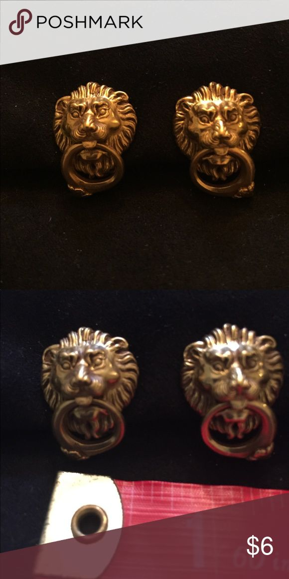 Call tone earrings with lion head detail Stunning and unique gold tone clip earrings.  Very detailed in the shape of a lion's head. Never worn.  Clip Jewelry Earrings