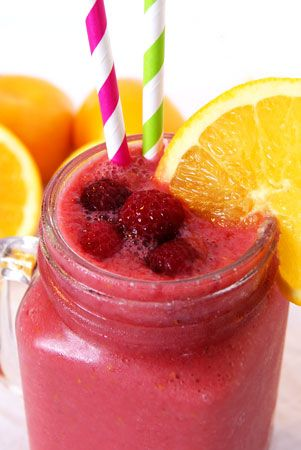 Banana Orange Smoothie made thick and creamy with frozen raspberries.