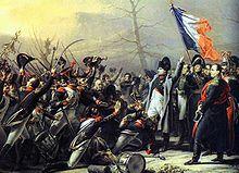 Cent-Jours : le ralliement du 5° d'infanterie de ligne à l'Empereur, le 7 mars 1815. - Averti à l'île d'Elbe de l'impopularité des Bourbons, Napoléon tente de ressaisir le pouvoir. Le 1° mars 1815, avec les mille grognards qui l'ont accompagné dans l'exil, il débarque à Golfe-Juan, proclamant superbement: L'aigle volera de clocher en clocher jusqu'aux tours de Notre-Dame.