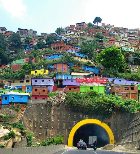 (caracas, venezuela)   I WAS OVERWHELMED BY THE POVERTY.  THESE STRUCTURES WITHOUT WINDOWS, BARELY STANDING, YET THERE WERE TV ANTENNAS ON THE ROOFS.......LAUREN