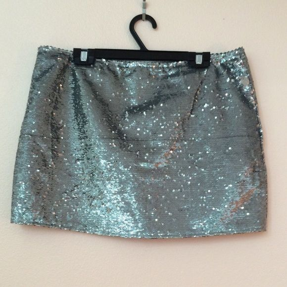 """Silver sequin mini skirt Silver all sequin straight skirt. Sewn in lining, side zipper. So many silver sequins layered together for a super shiny look. Brand is Blaque Label purchased at LuLus 100% polyester. Dry clean.  Size large. Measures 16.25"""" in waist, 13.5"""" long. Micro miniskirt.  In great condition, does have one loose thread. Only worn a couple of times. Great for girls night out or to glam up a look. Definitely a statement piece.  Reasonable offers accepted! Lulu's Skirts Mini"""