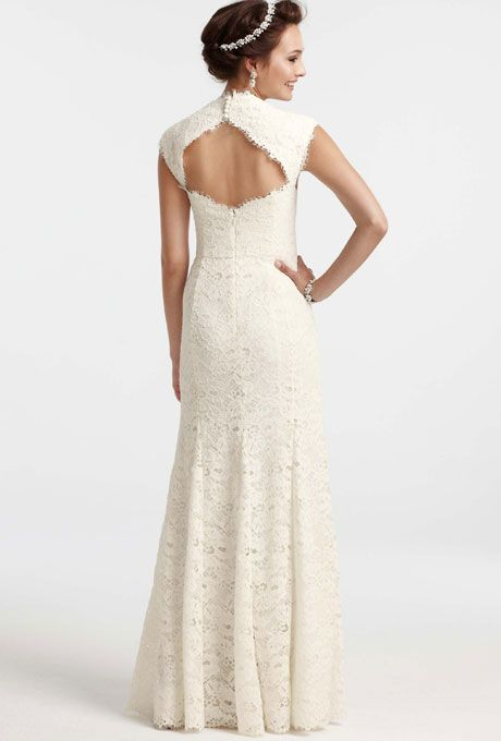 """Brides.com: Wedding Dresses We Love For Under $1,000. A cut-out back provides the ultimate peek-a-boo. We love the gown's raw-edge hem as well!   """"Isabella"""" wedding dress, $950, Ann Taylor  See more Ann Taylor wedding dresses."""