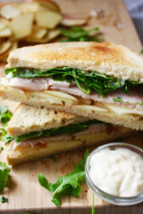 Turkey, Apple, and Brie Sandwich with Apple Cider Mayo: Crisp arugula and apple cider mayo brighten this tasty sandwich.This tasty turkey sandwich made with leftover Thanksgiving turkey can be eaten hot or cold. Find more easy and healthy turkey sandwich recipe ideas made from Thanksgiving leftovers here.