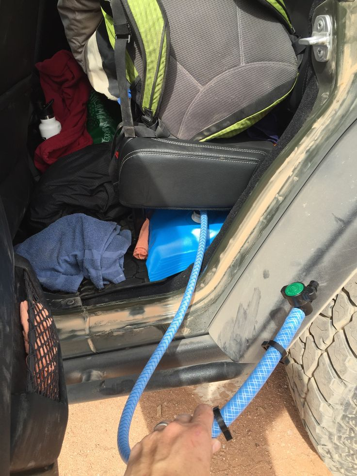 The ARB 55-liter water bladder fits very nicely under the backseat of the Jeep Wrangler Unlimited. Handy hose valve.