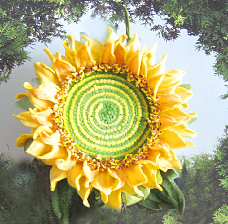 Sunflower brooch made with velvet and fabric.
