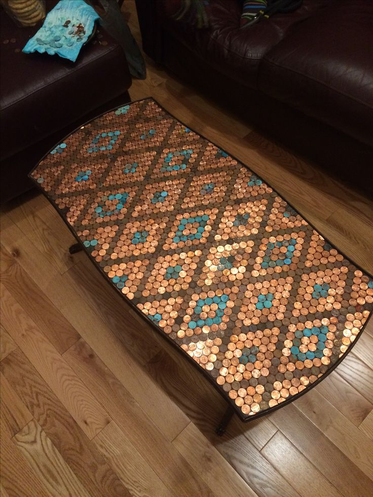Penny top table created with epoxy and corroded pennies