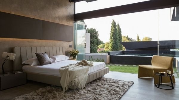 modern bedroom design glass wall neutral colors shaggy rug