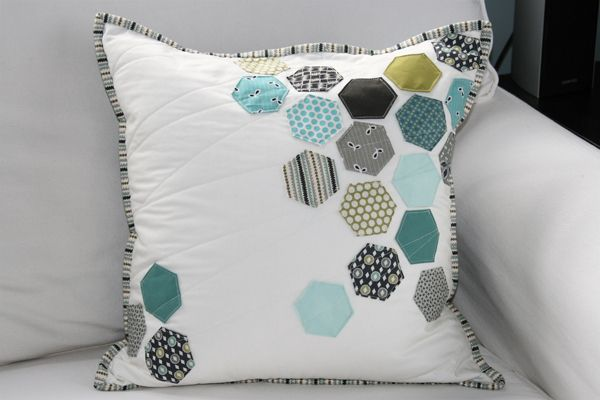 hexagon quilted pillow- I hope I'm clever enough to make this one day!