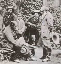 "proleutimpressionists: "" Cézanne Paul Cézanne (on the bench) in Pissarro's garden in Pontoise. Camille Pissarro is the man on the right. His son, Lucien, is the kid behind the bench. Musée Camille Pissarro, Pontoise, France """