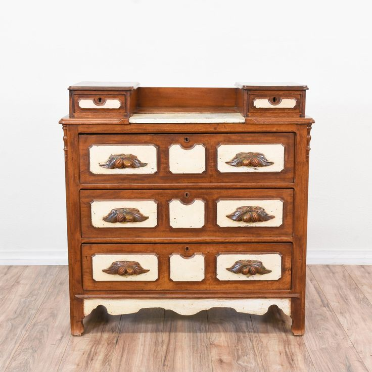 This antique vanity dresser is featured in a solid wood with a rustic maple finish and white painted panels. This dresser is in great condition with 3 large drawers, 2 small top drawers and intricate carved details. Eclectic eye catching storage piece! #eclectic #dressers #vanitydresser #sandiegovintage #vintagefurniture