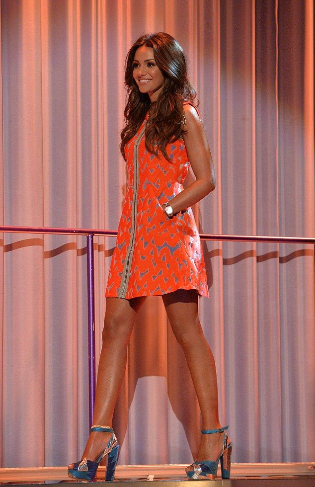 Leggy beauty: Michelle Keegan showed off her tanned pins in an orange dress as she appeare...
