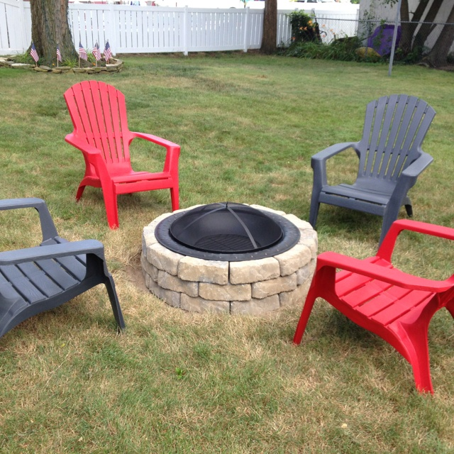 Stone fire pit love the adirondack chairs the great