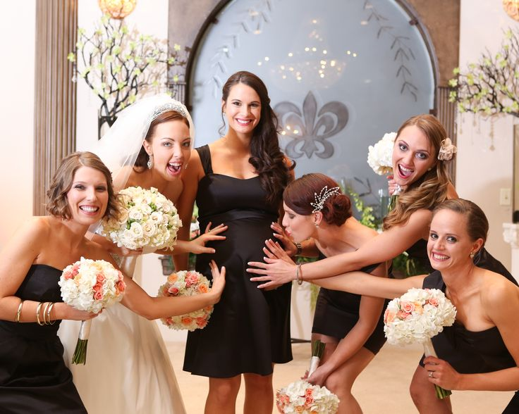 Pregnant bridesmaid photo idea: Give her a little moment to shine during the wedding photos! Also, the framed picture makes a great baby gift :)