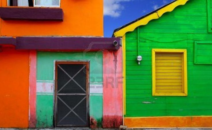 colorful Caribbean houses tropical vivid colors Isla Mujeres Mexico Stock Photo