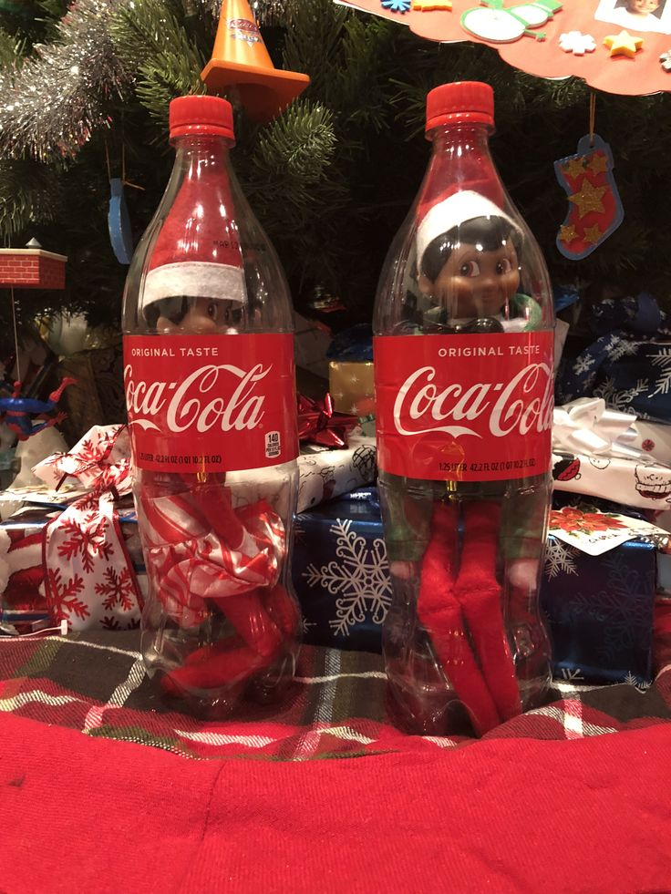 Elf's in a Coca Cola bottle