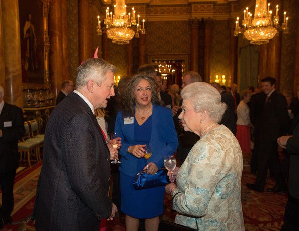 Louis Walsh speaks to Queen Elizabeth II at the Irish Community Reception at Buckingham Palace on March, 25, 2014. The reception is in a adv...