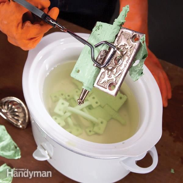 This works incredibly well!  I put a tin loaf pan in mine to contain the hinges though.                                                How to Remove Paint From Hardware -