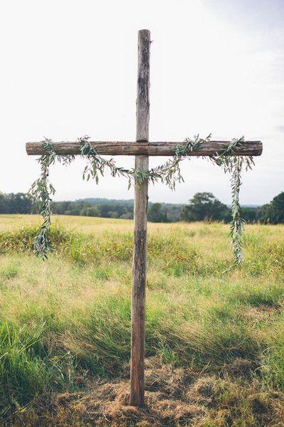 Fresh bay leaf garland draped on cross for wedding ceremony altar decor - simple,  modern, elegant {Brandy Angel Photography}
