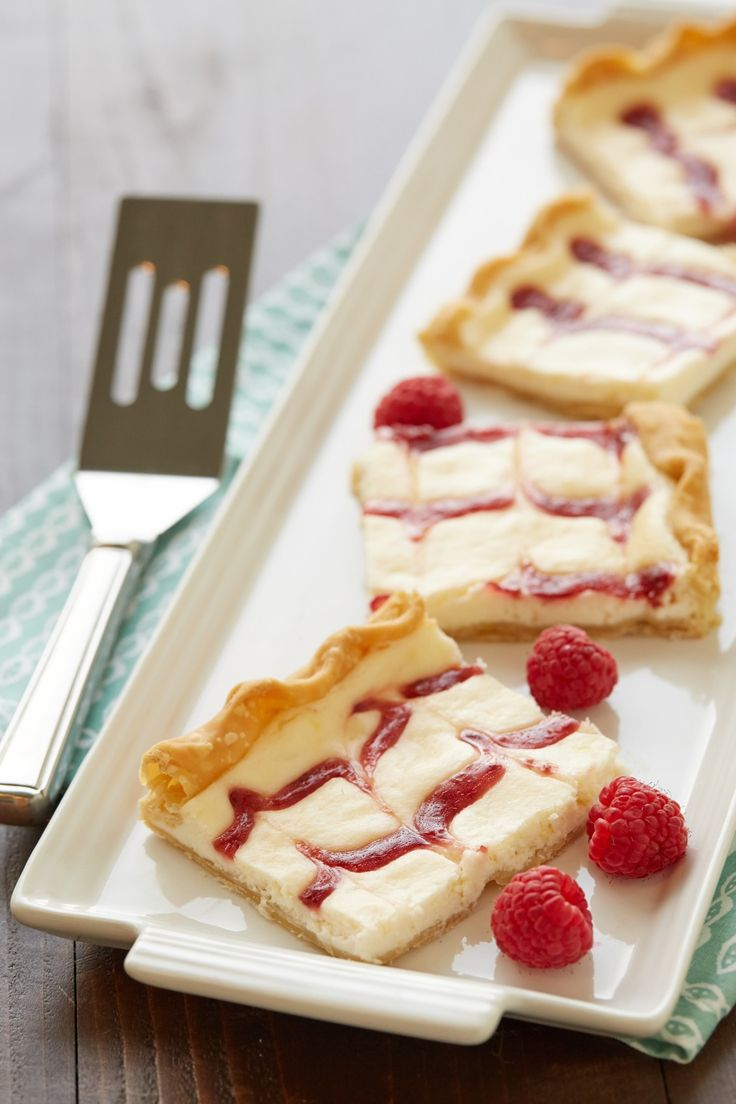 Lemon-Raspberry Cheesecake Slab Pie - Slab pie is an easy way to make dessert for a crowd, but this sweet, tart, creamy slab pie makes for an extra-special treat any day of the week.