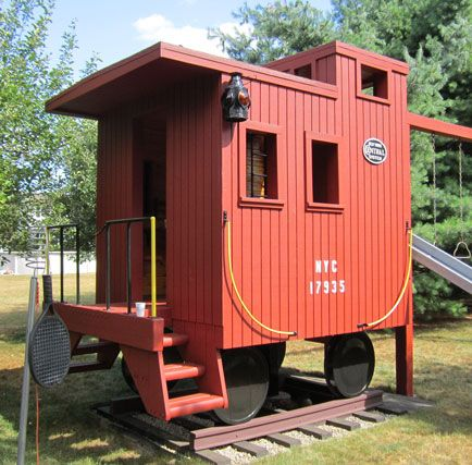Train caboose playhouse - we had one similar to this for our kids to play in.