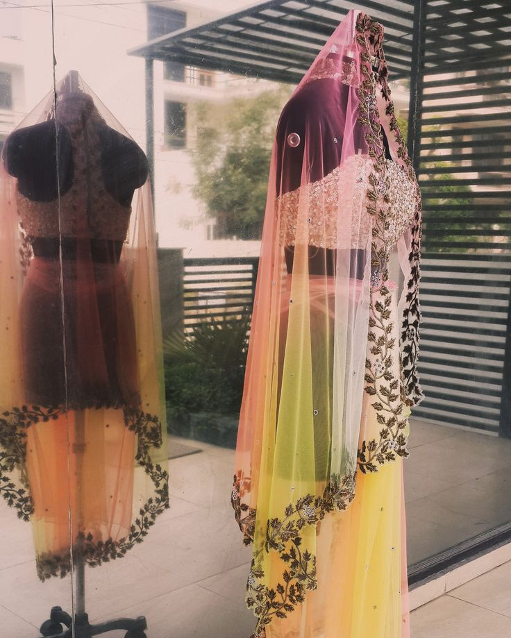 Shaded net drape with leaf embroidery on the border looks like a rainbow accompanied with a sequined strapless blouse.