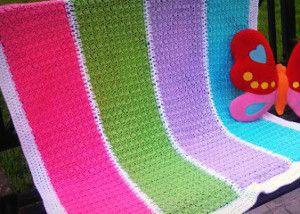 The colors of this Happy Ghan are so bright and cheerful, it's bound to put anyone in a happy mood! This free crochet afghan is super simple to make using worsted weight yarn and a G-sized hook, and it works up very quickly thanks to an easy repeating pattern stitch. Work this afghan up in your spare time and you'll be amazed at how quickly it's done.