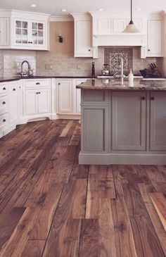 I love the dark wood floor, and if I did lighter cabnits and a darker top they would go together