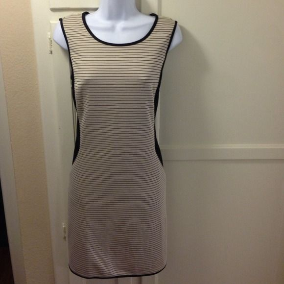 FLASH SALE! Black & cream bodycon Gorgeous black and cream body con dress. Has black side to give the hour glass look. Hidden pockets in front/side as shown in photo. You can't even tell that there is pockets there. Perfect going out dress. Very stretchy material. New without tags. Dresses